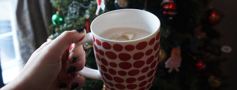 homemade vegan gingerbread latte in front of christmas tree