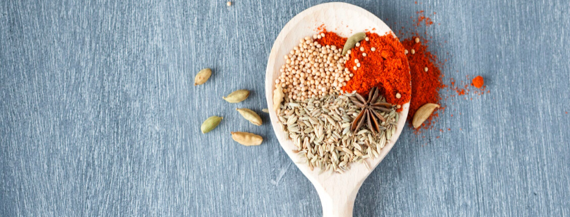 a spoon with herbs and spices - super herbs and spices
