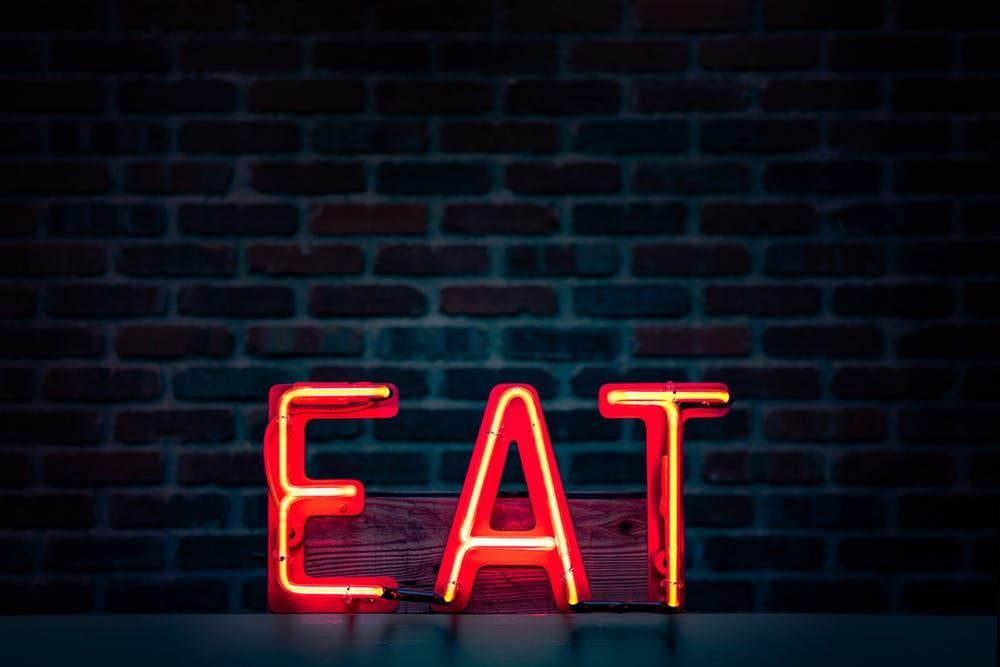 neon sign saying eat