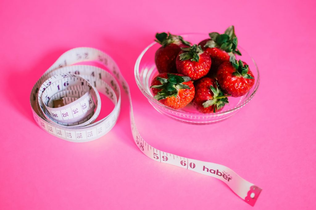 strawberries and measuring tape - why fitspo is just as harmful as pro-mia and pro-ana