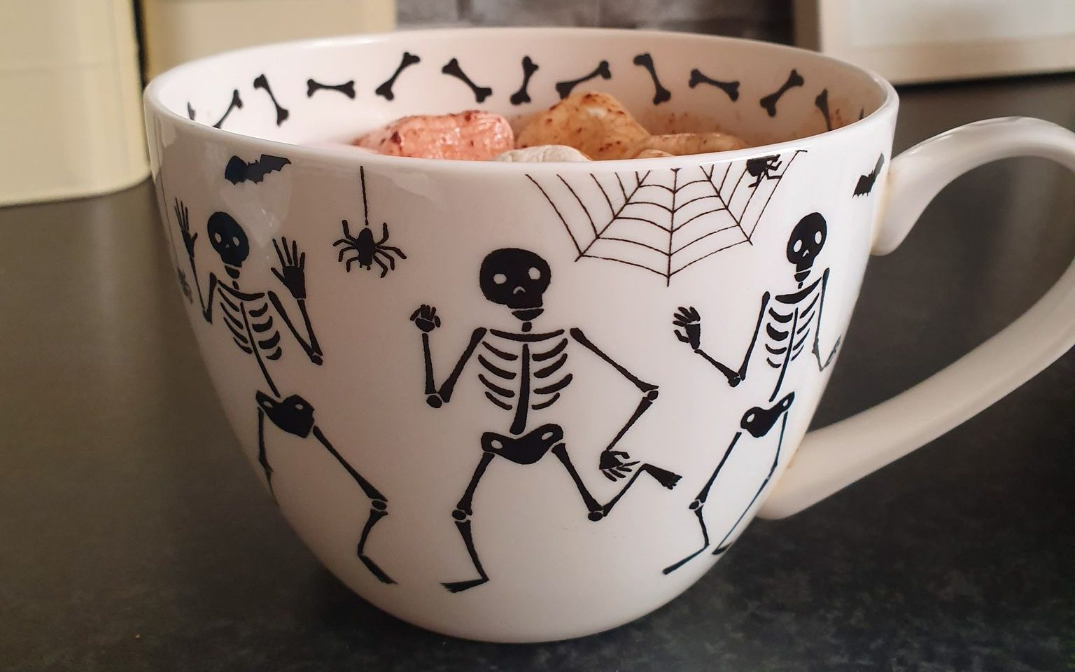 vegan pumpkin spice hot chocolate in  a skeleton mug