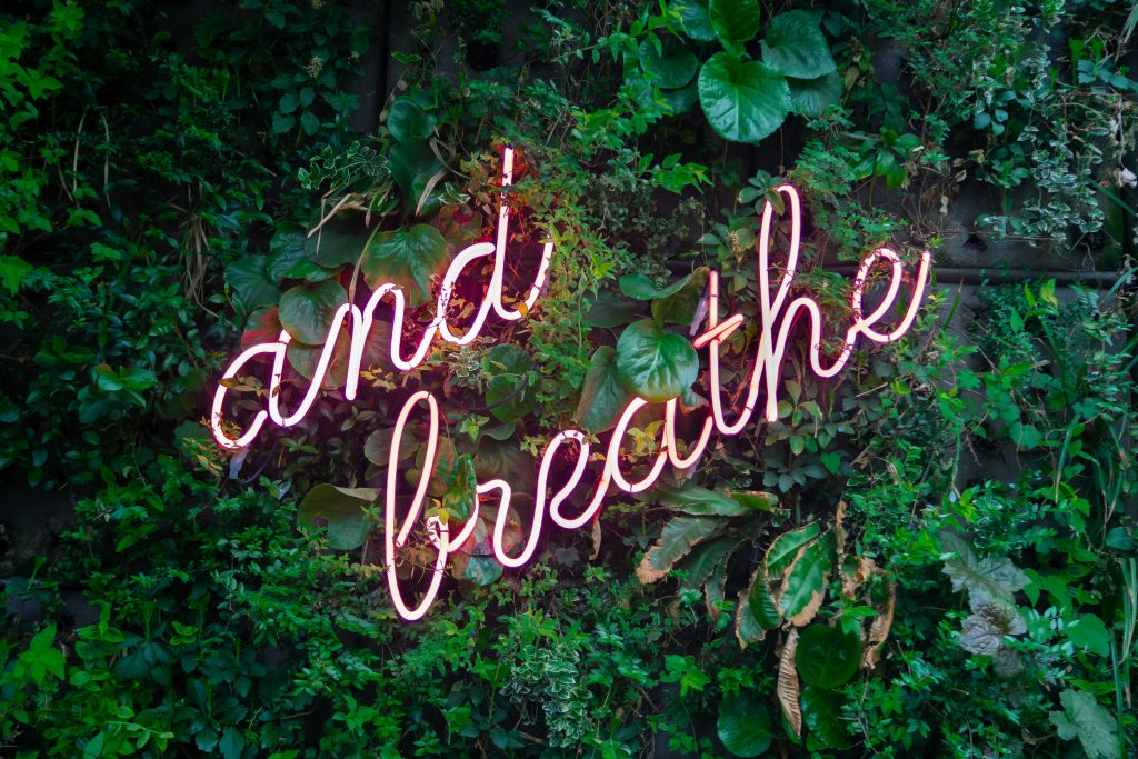 just breathe sign - self-care new years resolutions